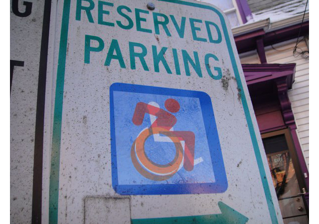 reserved parking sign with more dynamic accessibility icon