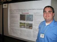 Image of Christopher Gaulke at poster presentation in Boston.