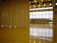 View of dance studio with curtain pulled halfway across room