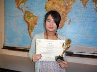 Akane Asada holding Trophy and Certificate from Bridges competition