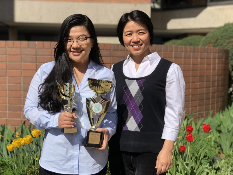 Yuanxia Liu and first place winner Jia Jin Xu pose with first place trophies.
