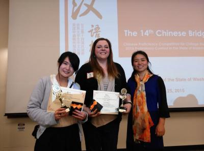 Yuanxia Liu with her students Akane Asada and Lauren Gilmore after placing in the Bridges Chinese Compition.