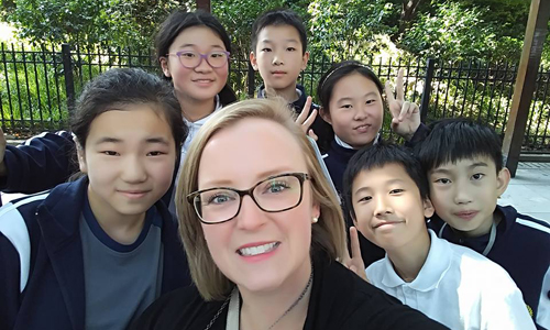 Rachel Gordon, OISP project manager, and six students in Shanghai, China