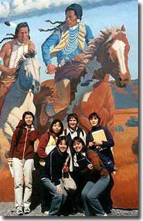 AUAP students standing front of Native American mural
