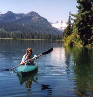 Tracey and Misha canoeing outdoors in nature