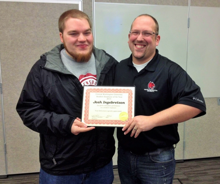 Doug and Josh holding a certificate