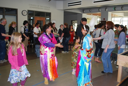 Yakama Nation International Dancers lead Earth Day participants in a dance.