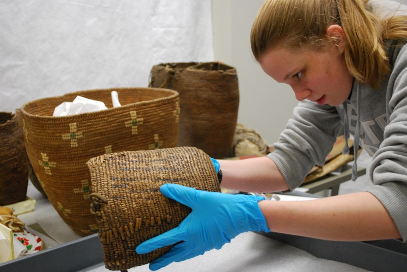 Student examining a basket