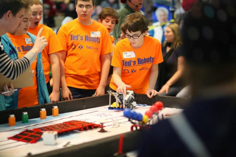 Teams of young people compete in a 2013 FIRST LEGO League robotics competition at CWU.