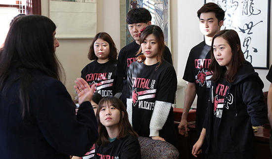 PHOTO CAPTION: Marilyn Levine, Central Washington University's provost and vice president for Academic and Student Life, speaks with a group of Korean students in her office.