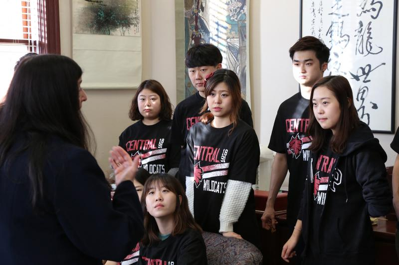 Marilyn Levine, Central Washington University's provost and vice president for Academic and Student Life, speaks with a group of Korean students in her office.