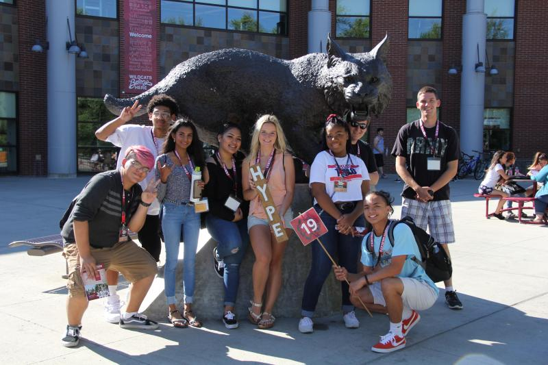 Students in front of Wildcat Statue
